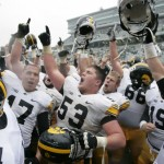 Iowa players celebrate a 19-16 win over Michigan State. Photo credit to Al Goldis/AP Photo