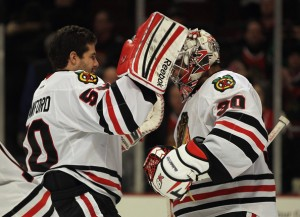 Crawford (left) and Emery (right) have proven to be an extraordinary goalie duo for the Chicago Blackhawks this season. (Photo: Jonathan Daniel/Getty Images North America)