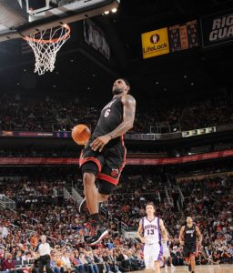 3 time MVP LeBron James soars high for another fantastic dunk.