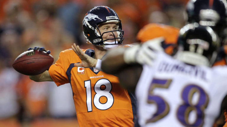 Denver Broncos quarterback Peyton Manning (18) throws for 7 touchdown passes Thursday night against the Baltimore Ravens. (Photo: Joe Mahoney, AP)