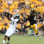 Iowa Hawkeyes wide receiver Tevaun Smith (4) jumps in the air over Michigan State Spartans cornerback Darqueze Dennard (31) for a first down on a 36-yard pass from quarterback Jake Rudock (15) of the homecoming game at Kinnick Stadium on Saturday, Oct. 5, 2013, in Iowa City. (Liz Martin/The Gazette-KCRG)
