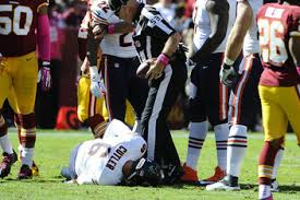 Jay Cutler lays injured on the field in the 2nd quarter of the Bears-Redskins game. (Photo by USATSI)