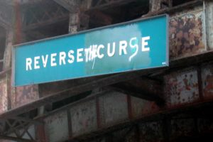 "The fan-altered ""Reverse Curve"" Sign in Boston (Source: Flickr)"