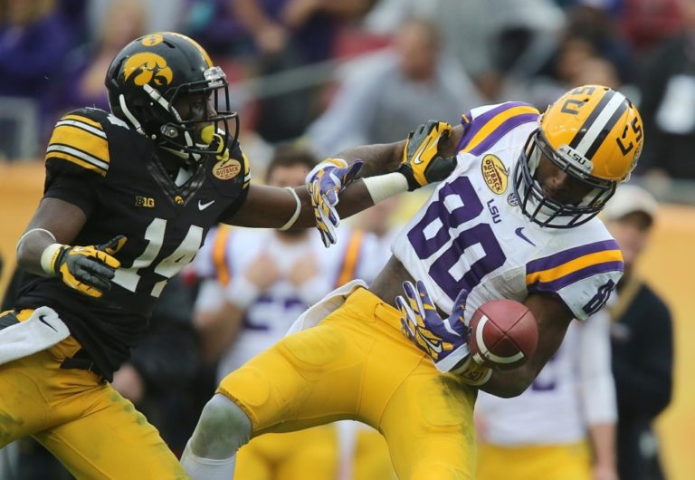 King defends a pass against LSU Receiver Jarvis Landry (photo: Bryon Houlgrave/The Register)