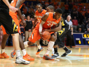 Melsahn Basabe and Rayvonte Rice battle for a loose ball during Saturday's game