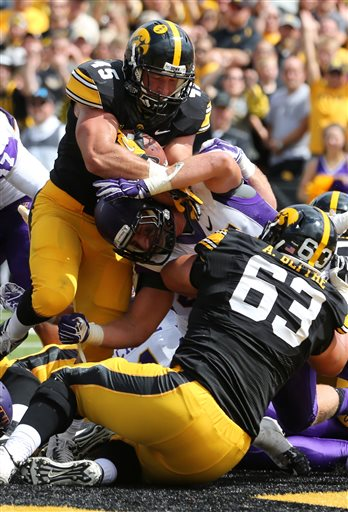Mark Weisman pushes his way to the goal line for a touchdown against UNI.