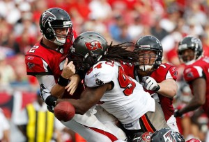 Adrian Clayborn delivers a hit on Atlanta Falcons quarterback, Matt Ryan. (Photo: Bucsnation.com)