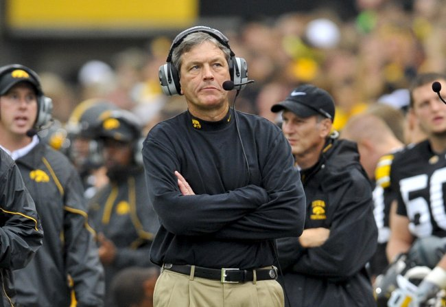 Kirk Ferentz somber glare at a scoreboard