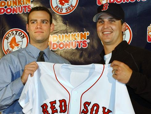 Keith Foulke holding Red Sox jersey at press conference.