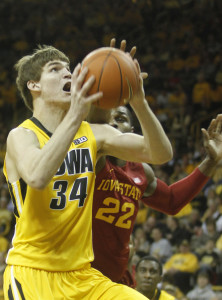 Adam Woodbury rises up for a right handed layup against an Iowa State defender