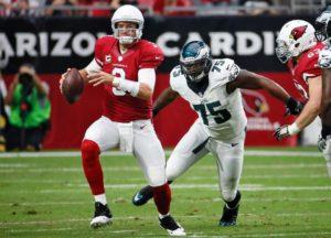 Cardinal's Quarterback Carson Palmer frantically escaping Eagles' pressure. Photo Credit: Arizona Cardinals.