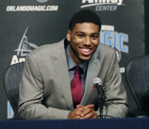 Devyn Marble smiling at podium of his introductory press conference in Orlando