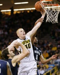 Aaron White drives to the hoop vs. North Florida in route to a game-high 23 points (Photo Credit: AP Photo/Charlie Neibergall).