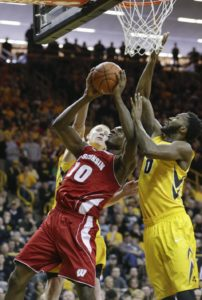 Iowa's Aaron White, left, and Gabriel Olaseni, right, double team Wisconsin's Nigel Hayes as Hayes goes to the basket during the first half of an NCAA college basketball game, Saturday, Jan. 31, 2015, in Iowa City, Iowa. (AP Photo/Jim Slosiarek)