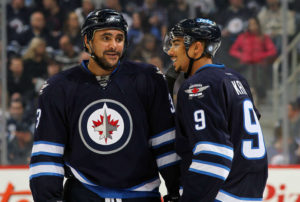 Dustin Byfuglien(left) and Evander Kane(right) will no longer be teammates following Kane's trade. The two have been teammates since the 2010-2011 season. (Photo: Jonathan Kozub/NHLI via Getty Images)