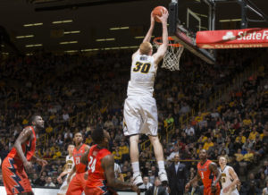 Iowa Hawkeyes forward Aaron White (30) dunks the ball during the second half of their game against the Illinois Fighting Illini Wednesday, Feb. 25, 2015 at Carver-Hawkeye Arena. (Brian Ray/hawkeyesports.com)