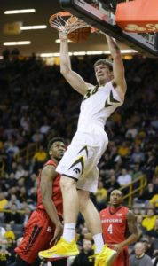 Adam Woodbury threw down an early dunk that sparked Iowa early in the blowout win (Photo: AP Photo/Charlie Neibergall).