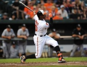 Adam Jones blasts a home run. (Photo Credit: Associated Press)