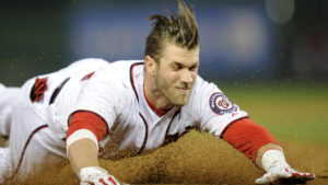 Bryce Harper dives into the base. (Photo Credit:Max Scherzer delivers a pitch. (Photo Credit: Al Bello/Getty Images)