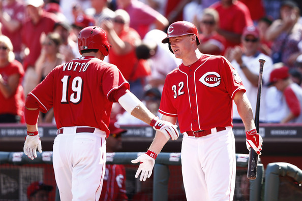 The Cincinnati Reds celebrate a run scored. (Photo Credit: Joe Robbins/Getty Images North America)