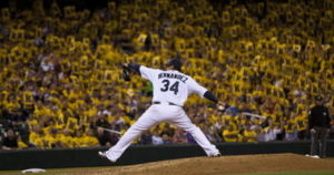 King Felix delivers a pitch as his fans hold up K(strikeout) signs. (Photo Credit: AP Photo)