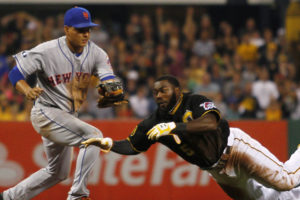 Josh Harrison dives for third while avoiding the tag. (Photo Credit: Getty Images)