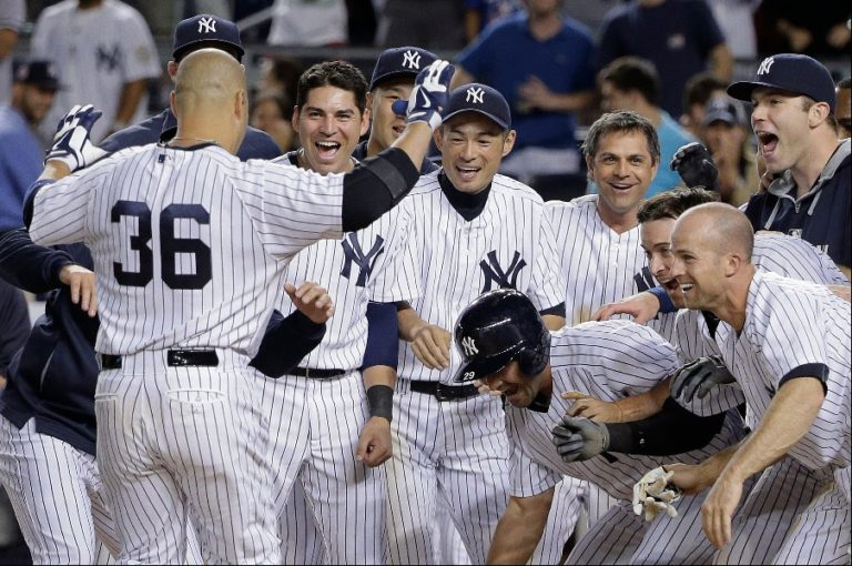 The New york Yankees celebrate a victory. (Photo Credit: Julie Jacobson/AP)