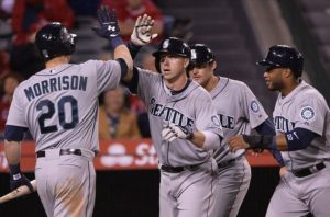 The Seattle Mariners celebrate a run scored. (Photo Credit: Robert Hanashiro-USA TODAY Sports)