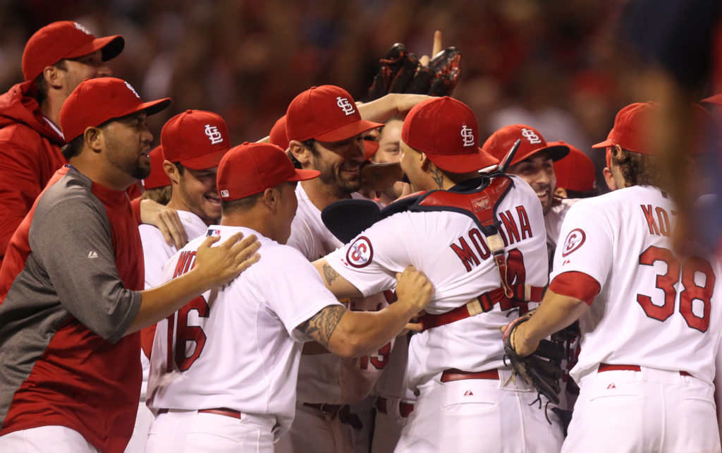 The St. Louis Cardinals celebrate, after they clinch the NL Central. (Photo Credit: UPI/Bill Greenblatt)
