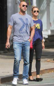 Derek Jeter in jeans walking with his girlfriend.