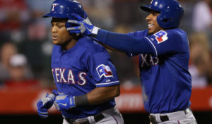 Elvis Andrus messes with Adrian Beltre as they round the bases. (Photo Credit: Jeff Gross/Getty Images)