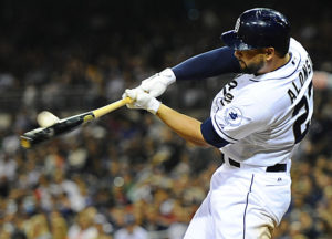 Yonder Alonso crushes a ball to right field. (Photo Credit: Christopher Hanewinckel-USA TODAY Sports)