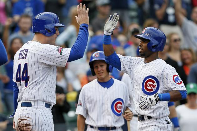 The Chicago Cubs celebrate a run scored. (Photo Credit: Andrew Nelles/Associated Press)