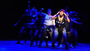 Whatsername leads women in musical number during dress rehearsal, courtesy of UI Theatre