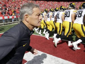 Kirk Ferentz leads the Hawkeyes onto the field. (Photo Credit: Morry Gash/Associated Press)