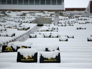 Seats covered with snow inside Kinnick Stadium. (Photo Credit: AP Photo)