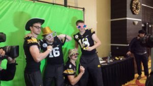 C.J. Beathard and his teammates take a picture in front of the green screen. (Photo Credit: Camden Palmisano)