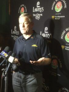 Kirk Ferentz talking to the media