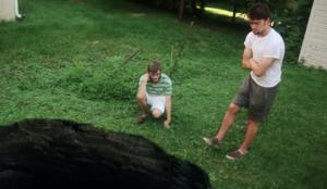 "Alosha and Carter stare into ""The Pit"""
