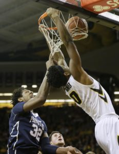 Iowa forward Ahmad Wagner dunks over Penn State center Jordan Dickerson, left, during the first half of an NCAA college basketball game Wednesday, Feb. 3, 2016, in Iowa City, Iowa. (AP Photo/Charlie Neibergall)