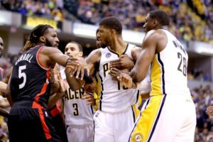 Pacer and Raptors players get into a fight on the floor (Andy Lyons/Getty Images)