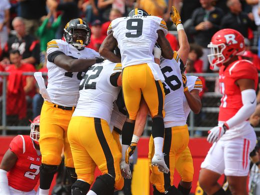 Iowa celebrates after scoring a touchdown in Highpoint Solutions stadium. (Photo credit: Ed Mollholland, USA Today Sports)