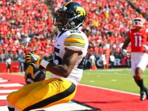 Iowa RB Akrum Wadley celebrates after scoring the go-ahead touchdown in his home state (Photo Credit: Ed Mulholland, USA Today Sports)