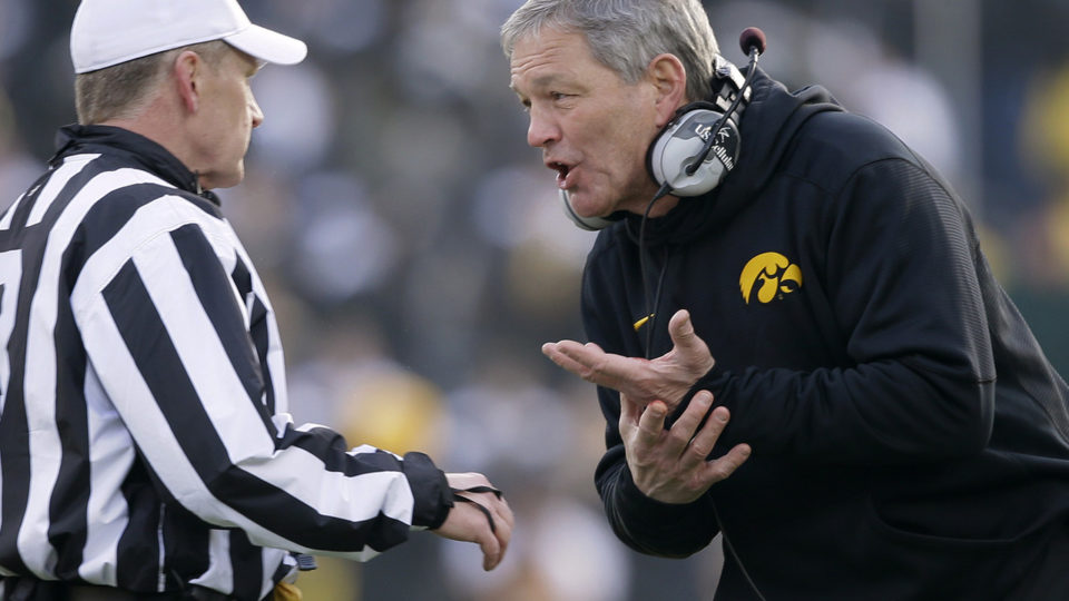 Kirk Ferentz arguing with a referee