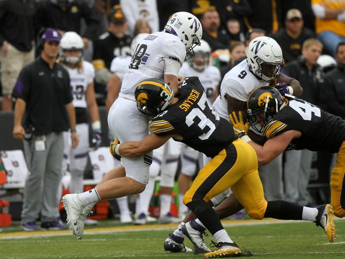 Iowa defensive back Brandon Snyder (37) makes a hit on Northwestern Quarterback Clayton Thorson during the Homecoming game on Saturday October 1st. (Photo credits: David Scrivner / Iowa City Press-Citizen)