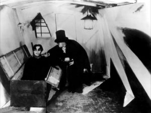 Dr. Caligari feeds his somnambulist.