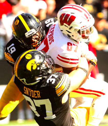 Miles Taylor (19) and Brandon Snyder (37) attempt to bring down Wisconsin receiver Quintez Cephus after a big pass play. Wisconsin defeated Iowa 17-9 on October 22nd at Kinnick Stadium in Iowa City (Photo cred: Quad City Times, via John Schultz).