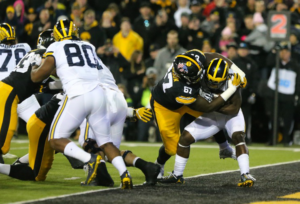 Defensive lineman Jaleel Johnson (67) tackles De'Veon Smith in the endzone to record a safety for the Hawkeyes in their 14-13 win over Michigan (via The Daily Iowan, Margaret Kispert, Alex Kroeze).