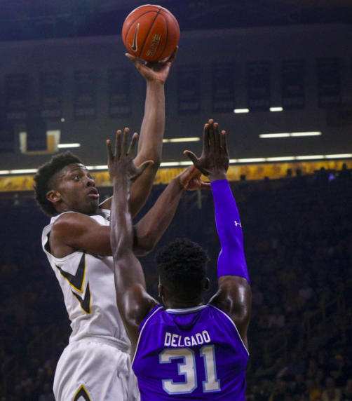 Iowa forward Tyler Cook (5) shoots over Seton Hall's Angel Delgado (31) in Thursday's 91-83 loss to the Pirates in the Gavitt Games (via Quad City Times, Andy Abeyta).