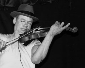 Tony Conrad performing at the Knitting Factory in NYC on April 28, 1994. Pitchfork.com